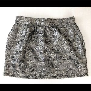 New silver skirt w/ pockets, exposed back zipper